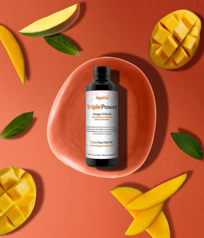 Bottle of Triple Power Fish Oil surrounded by mango