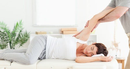 Chiropractor adjusting woman