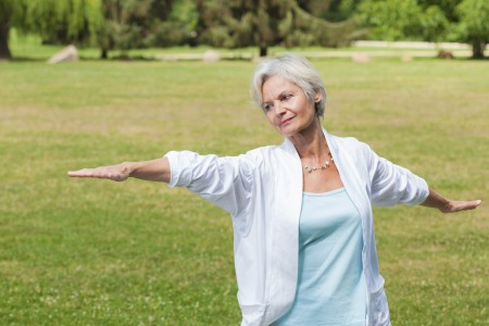 Senior women doing tai chi to help osteoporosis