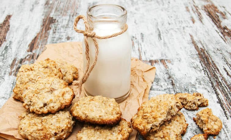 oatmeal cookies and milk on a old wooden background