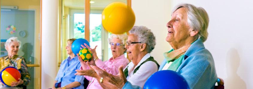 Senior Women Exercising While Sitting With Ball