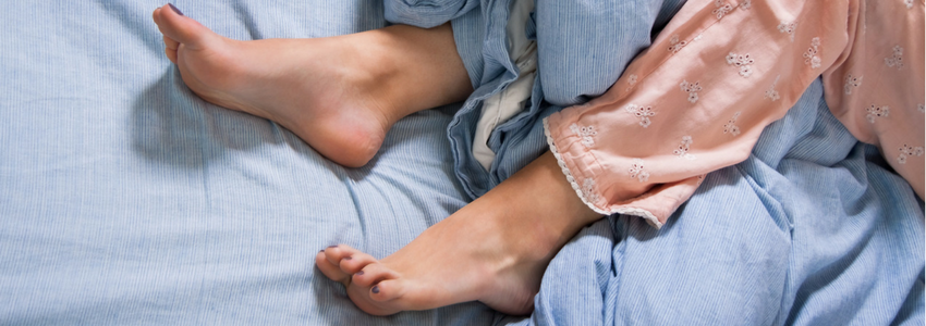 Natural Sleep Aids - picture of sleeping woman feet exposed