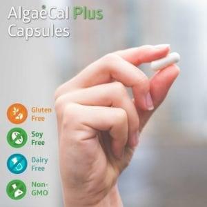 Hand holding an AlgaeCal Plus capsule
