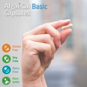 Hand holding an AlgaeCal Basic capsule