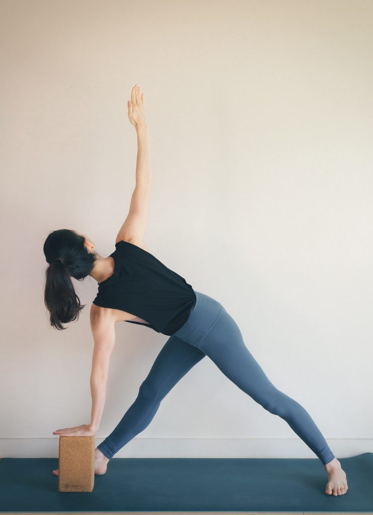 Parivrtta Trikonasana (Twisted triangle) — Osteopenia