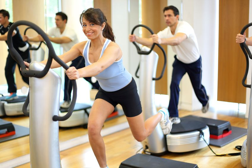 Woman using vibration machines