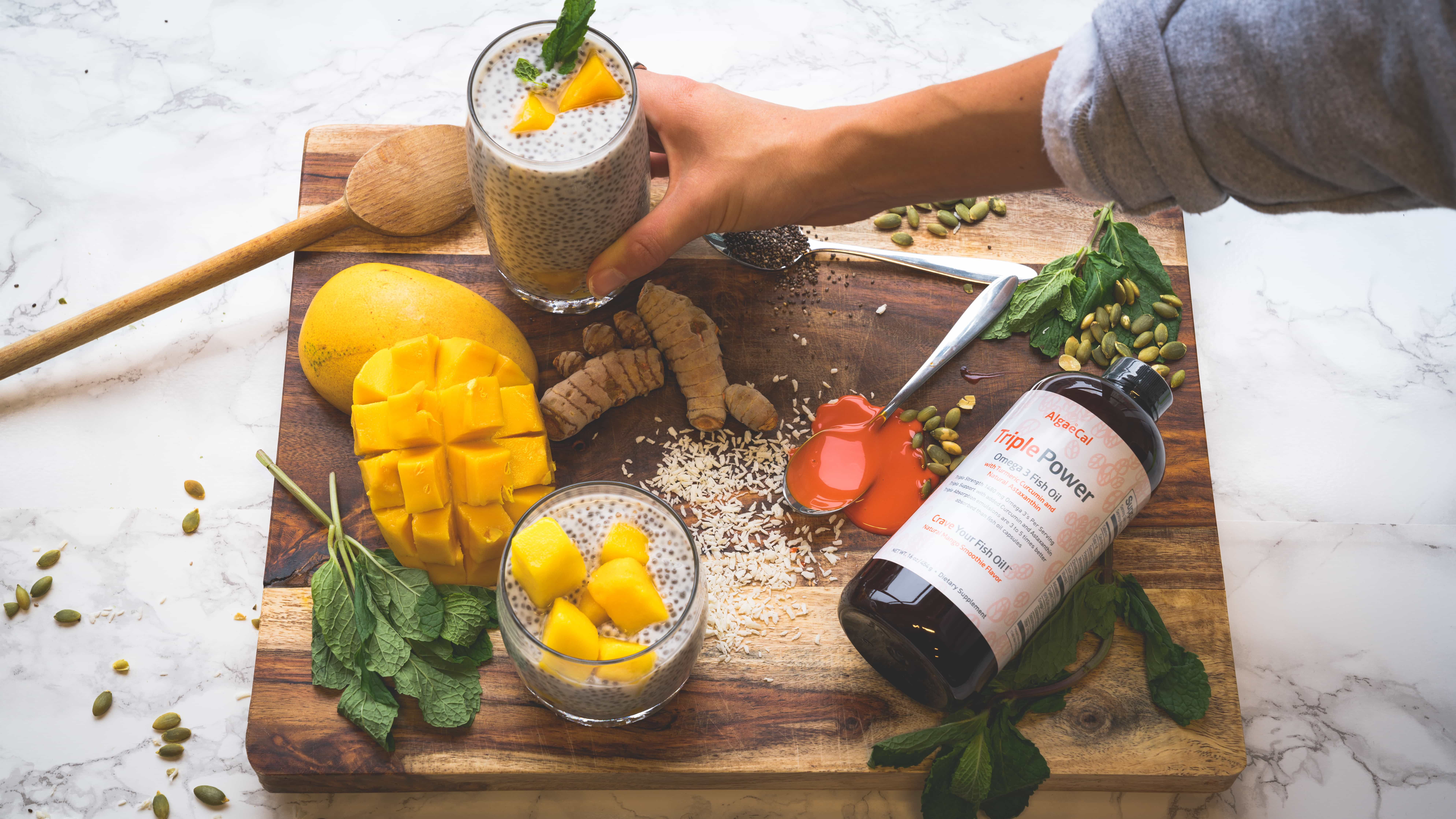 Chia Pudding in cups with mango, turmeric and mint