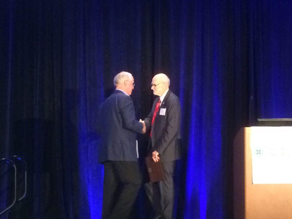 Dr. Kaats accepting the Ragus Award