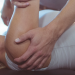Woman on table getting shoulder worked on