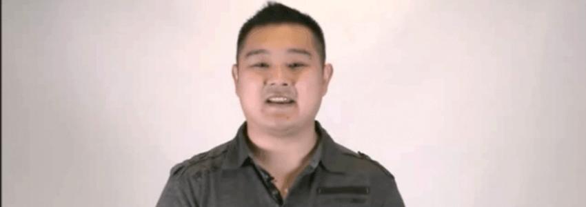 Kyle Lim in black collared shirt