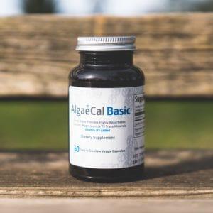 AlgaeCal Basic bottle on a park bench