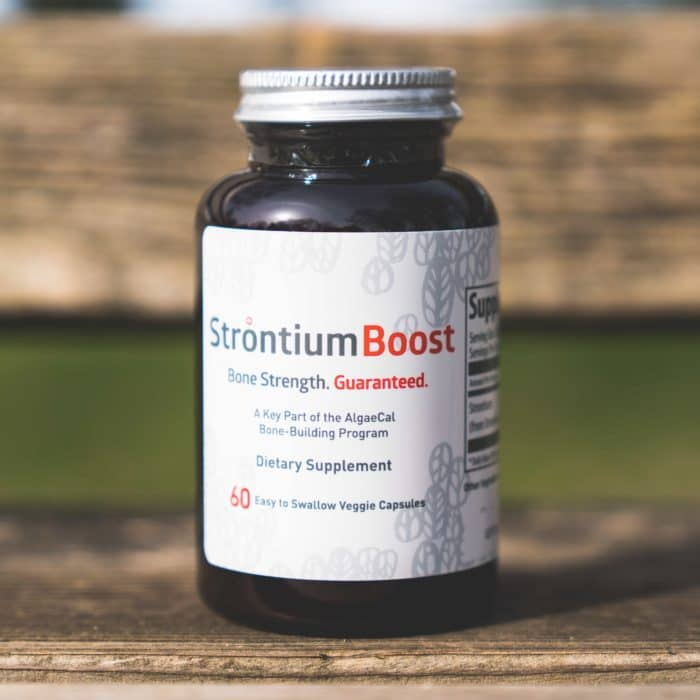 Strontium Boost bottle on a bench