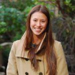 Monica Lam-Feist in beige trench coat