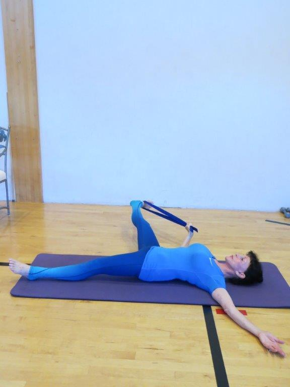 Supine hand to foot 2 pose