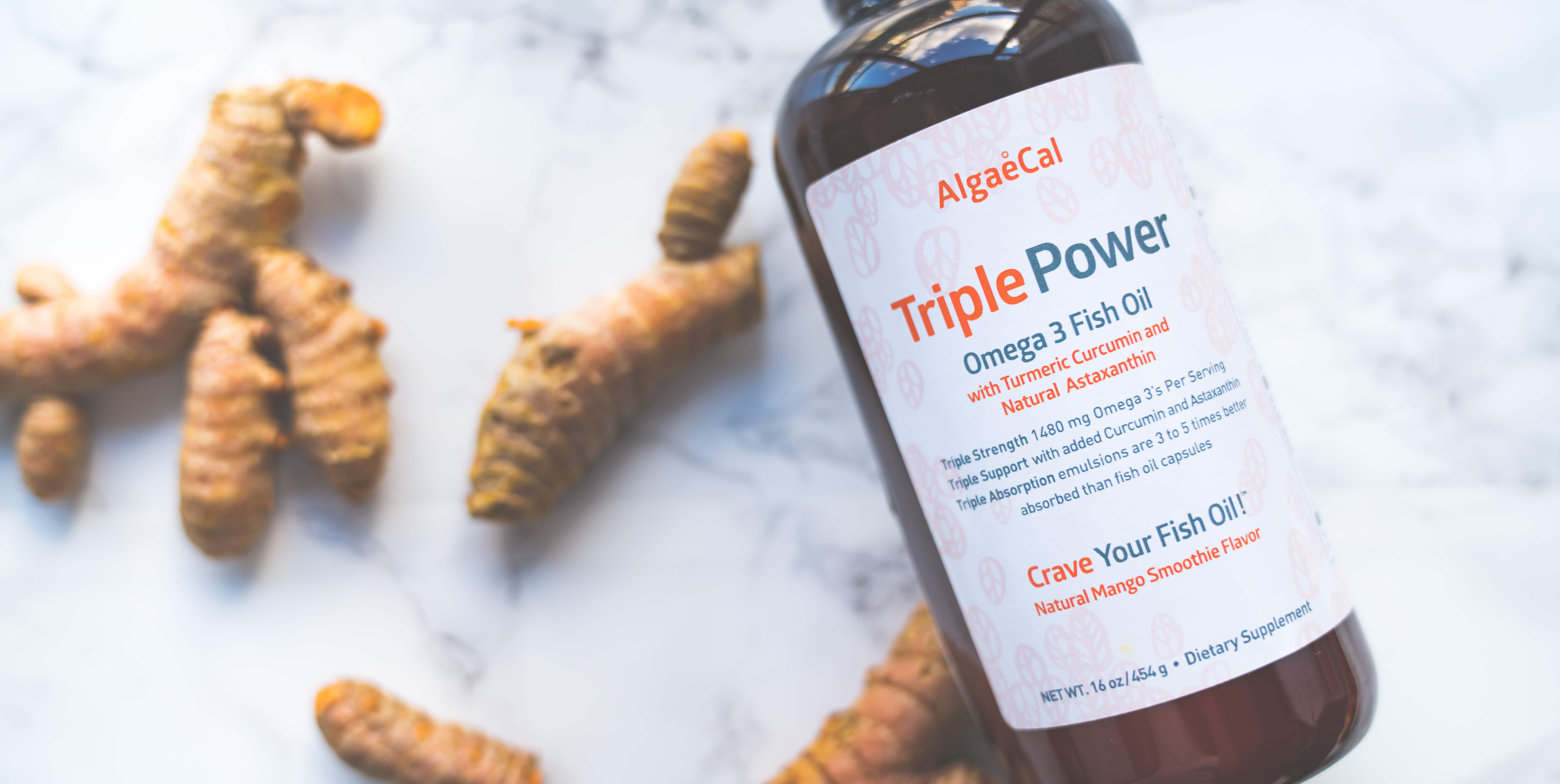 Fresh turmeric root with Triple Power bottle