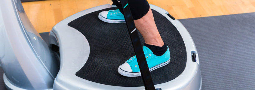 Woman on vibration plate