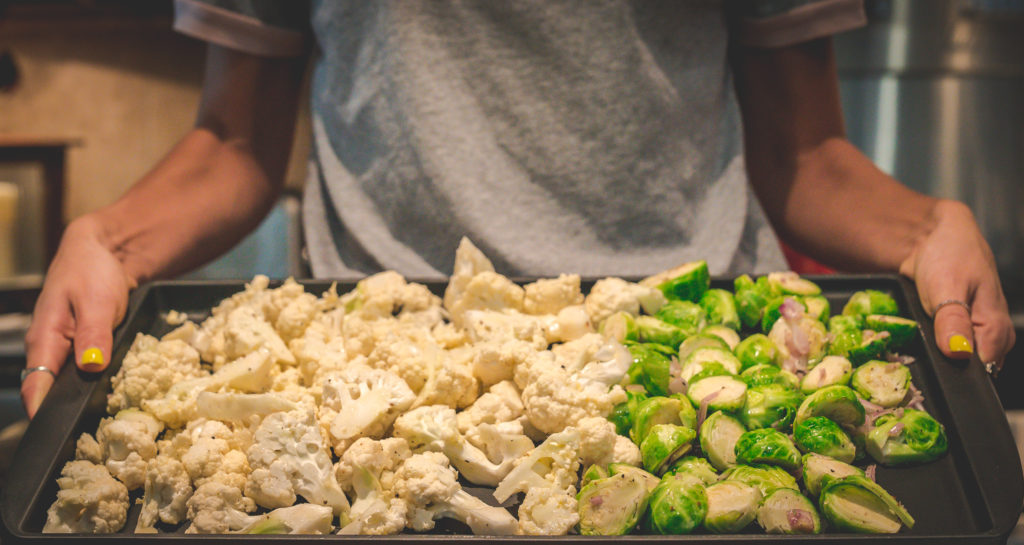 cauliflower and brussels sprouts on a pan