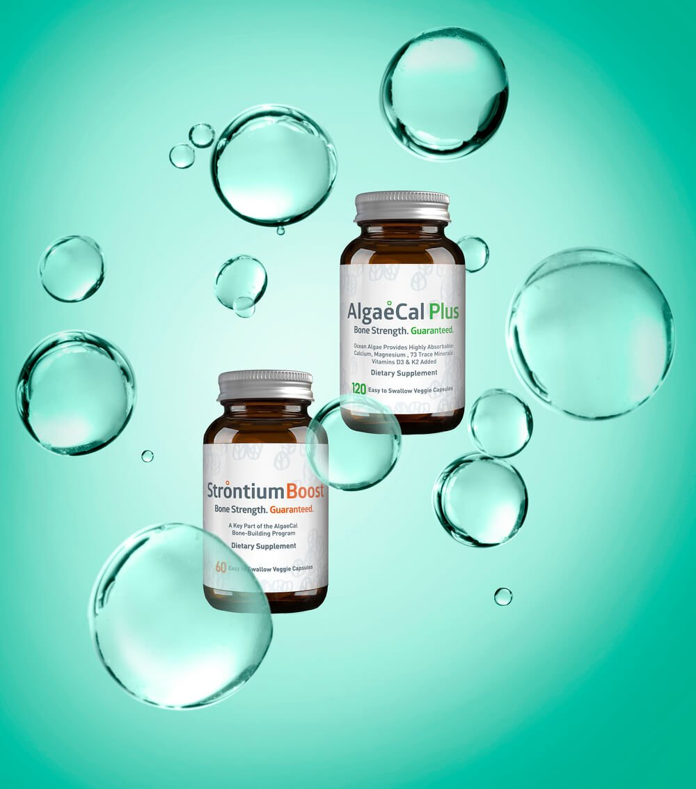 AlgaeCal Plus and Strontium Boost bottles with bubbles and algae