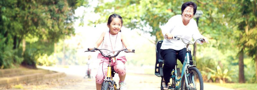 Mother and daughter enjoying bike ride in the park together