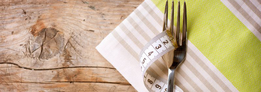 Fork and measuring tape on a napkin