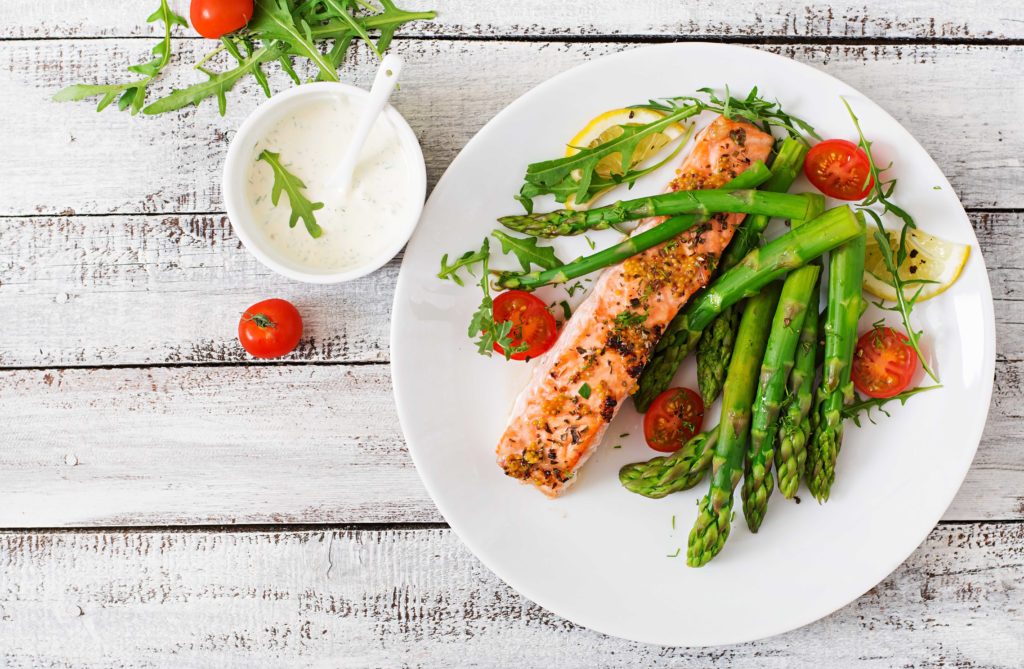 baked salmon with herbs, tomatoes and asparagus