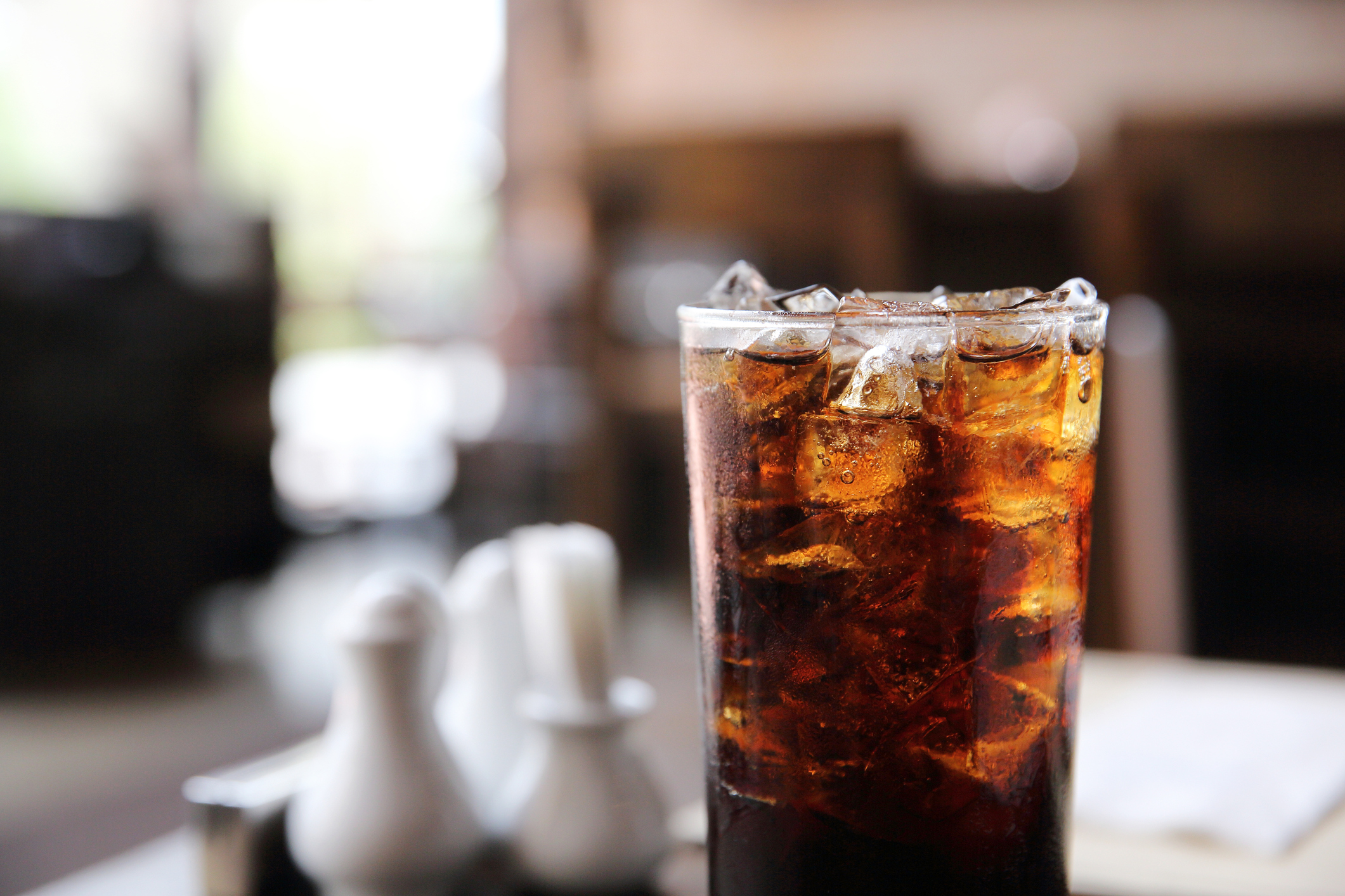 Cola drinking on wood background