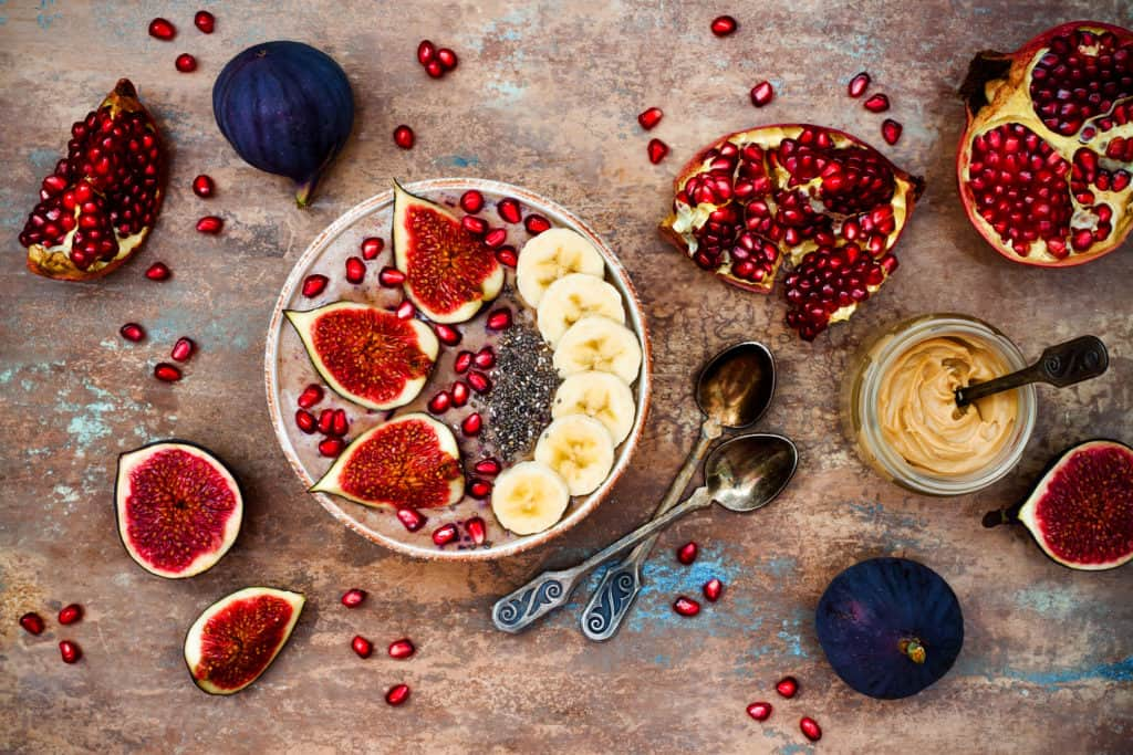 Breakfast acai superfoods smoothies bowl with chia seeds, hazelnut butter.