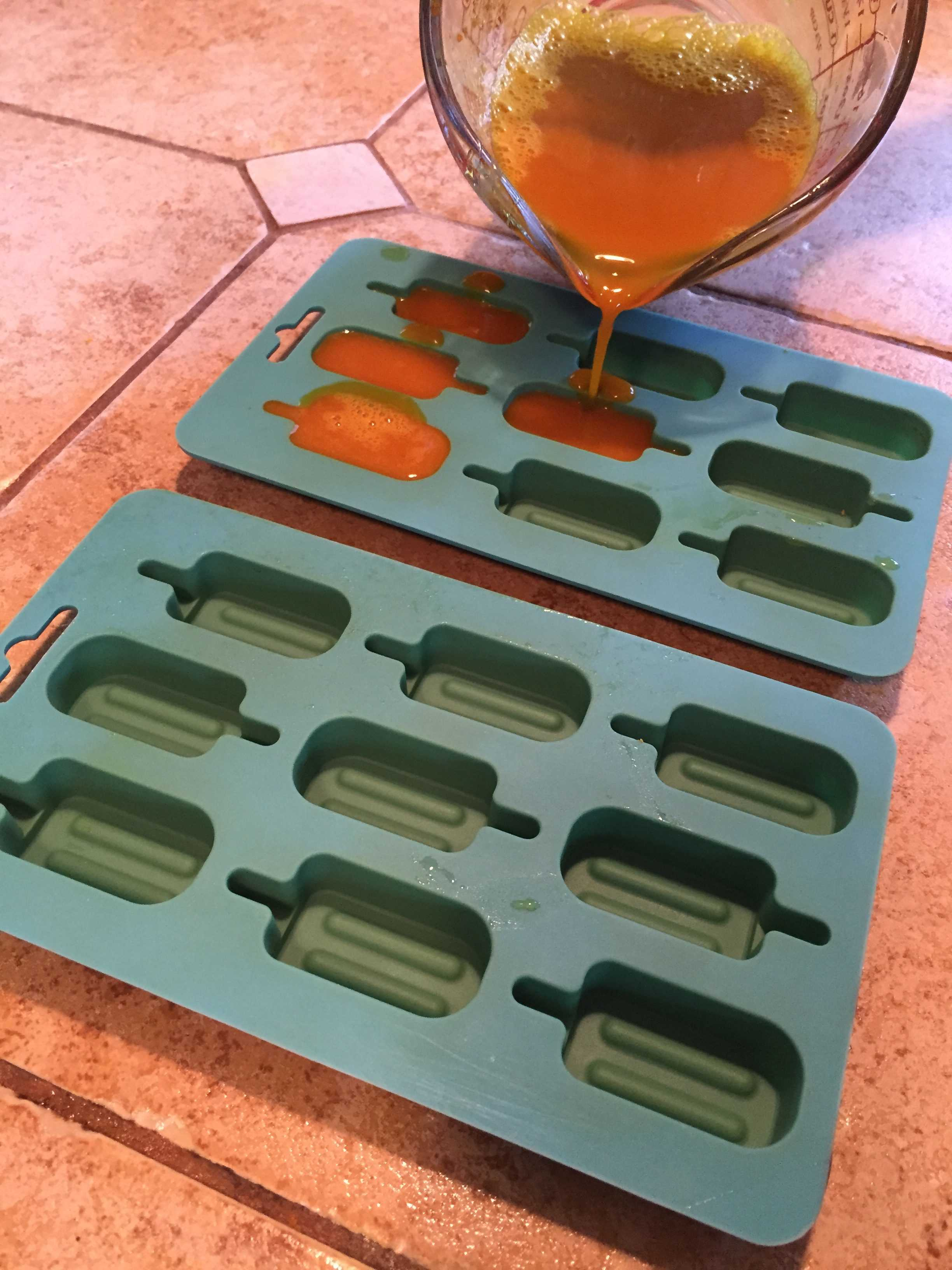 turmeric gummies being poured into molds