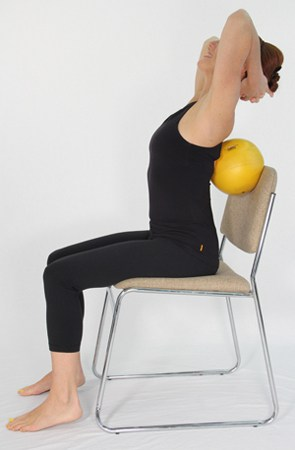 Exercises for osteoporosis: Ball Behind Back Thoracic Extension, Step 2
