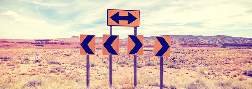 Signs pointing in different directions