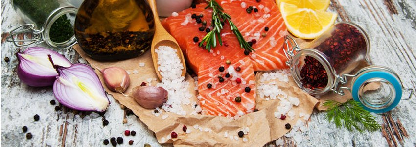 Salmon steaks and ingredients spread out