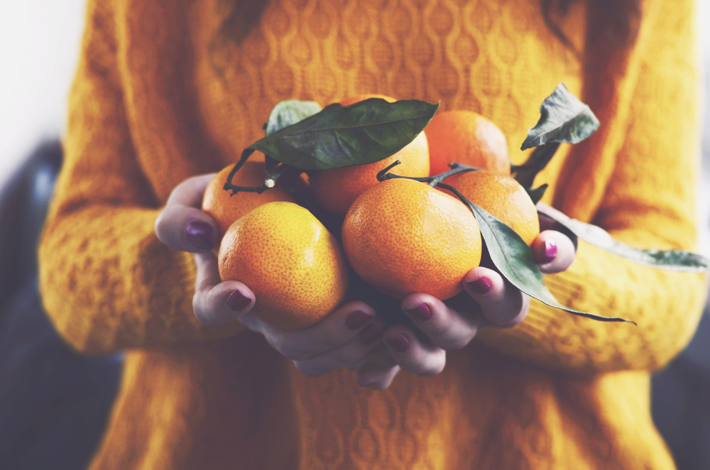 Vitamin C - oranges in a womans hand