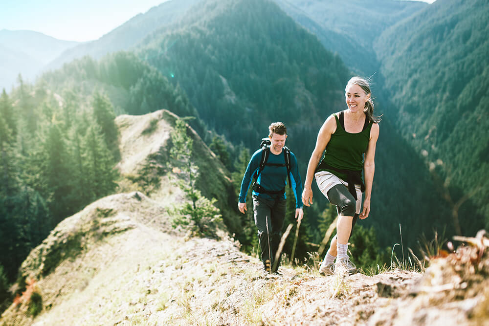 Woman and man hiking on a trail